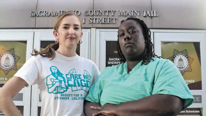 Two women stand in front of Sacramento County Jail