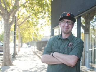 Jonathan Tate stands in front of King Cong Brewing on Del Paso Boulevard.